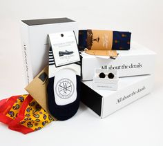 2016 August Box - John Lennon sunglass tie bar by Dappertude, Pineapple tie by OTAA, Silk pocket square by Moustard and loafer socks by William and Sterling.
