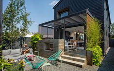 Multi-level outdoor living with retractable screen, two-sided fireplace, privacy screening