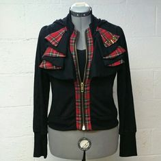 Plaid sweater Sexy plaid ruffle zip up hoodie jacket. Never been worn. Light, Soft, Stretchy & Sporty. Definitely a unique piece! Junior xl in size, bust measures 20in unstretched across, length measures 21in. Arm length from shoulder to hem is 26in. Poly/Rayon/Spandex mix. No trades, no holds, bundle and Save. Price firm. Rocawear Sweaters