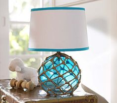 Since we're doing a beachy/ocean theme...LOVE this!!! Rope Complete Lamp #PotteryBarnKids