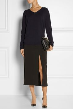 JIL SANDER Cashmere sweater $830 EDITORS' NOTES & DETAILS Jil Sander's cashmere sweater is a wardrobe staple. This navy design has a classic, relaxed silhouette. Dress it up with a skirt and pumps.