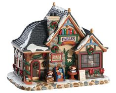 High quality lighted building Fables Bookstore from the Caddington range. Lemax Christmas Village houses are renowned for their attention to detail and look great on their own or used as part of a larger display. Village Lemax, Lemax Christmas Village, Christmas Mantels, Christmas Villages, Christmas Home, White Christmas, Victorian Christmas, Christmas Trees, Vintage Christmas