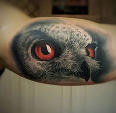 Red-eyed owl tattoo by Csorsz Peter
