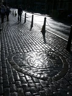 The Heart of Midlothian sits outside St Giles Cathedral,  Edinburgh, Scotland. Spit on it for good luck