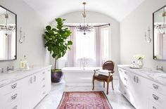 Rugs 101: Your Ultimate Guide to Rug Shopping // pink Persian rug, marble countertops, marble floors, white bathtub, chandelier
