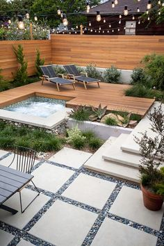 The unique design of the patio and the use of greenery against the wood walls makes this space beautifully modern.