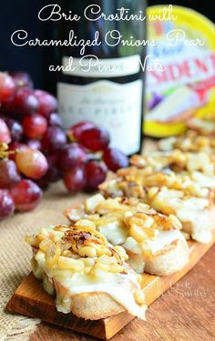 Brie Crostini w/ Caramelized Onions, Pear and Pine Nuts | from willcookforsmiles.com #crostini #brie