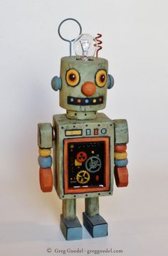 Robot wood carving by Greg Guedel. Inspired by vintage tin toys.   www.gregguedel.com