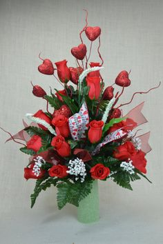Valentine Red Roses Cemetery Flower Arrangement  This Beautiful Red and White Roses 3 Inch Cemetery Vase Flower Arrangement is made with Red Rose Buds and Green Fern .The arrangements is trimmed with ribbon and Large Red Heart to make this arrangement perfect for your loved one for Valentines Day.    The red roses are accentuated by the whites of baby breath and complemented by the green ferns: The classic Valentines Day arrangement.  +++++    Size: 22 x 16 x 16  +++++   +++++  For more…