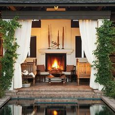 patio fireplace, pergola, outdoor fireplace, outdoor curtains, amazing covered patio deck with brick steps,