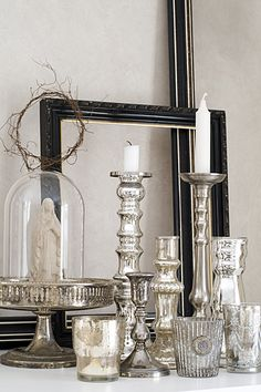 Pedestal arrangments with 2 candlestick arrangements staggered and flowers on perimeter of pedestal and glass ball mounted up on side to stagger with other 2 cs holders 3 goal points total. Candle Lanterns, Candle Sconces, Mercury Glass Decor, Decoration Christmas, The Bell Jar, Apothecary Jars, Christmas Home, Silver Christmas, Dream Decor