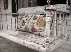 LOVE this weathered white porch swing!