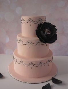 Simple wedding cake with dot drapes and sugar peony.  Lana's Dough Delights, specializing in custom cakes, cupcakes and cookies.