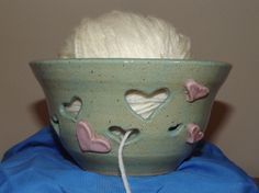Hearts Yarn Bowl was made from stoneware speckled clay on my pottery wheel and glazed in a turquoise with pink hearts.