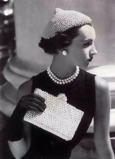 Vogue - 1950 No fuss, just clean lines and simplistic style even with the small business of the bag and the hat