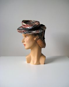 vintage early 1940s daytime tilt hat  silky plaid nylon  black grosgrain ribbon wraps around crown  and hangs down in pieces at the back  crown is