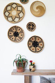 Baskets as wall art.