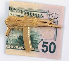 AK-47 Money Clip / Wallets are for chumps, if you really want to tote around your fat stack of dough like a true shot-caller you need the AK-47 money clip. http://thegadgetflow.com/portfolio/ak-47-money-clip-280/