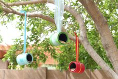 Thanks to brightly hued ribbon and unused paint cans (available at home improvement and craft stores), these colorful feeders double as birdhouses. You can also craft them from leftover coffee cans. Get the tutorial.  - GoodHousekeeping.com