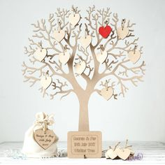 Are you interested in our wooden wishing tree ? With our personalised wedding guestbook you need look no further.