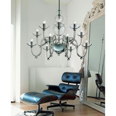 """<p><span><span+lang=""""EN-GB"""">The+diffuser+consists+of+handmade+blown+glass+in+the+color+crystal.+The+construction+of+this+chandelier+consists+of+chromed+or+gilded+metal.+</span></span></p>"""