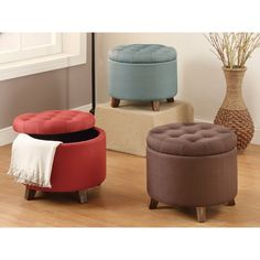 Add a hint of color to your living space with these circular shaped ottomans upholstered in fabric with accent tufting on the seat cushion. Each ottoman includes a removable top and storage space for toys, storing blankets or magazines.