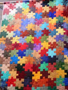 Jigsaw quilt.  I wish I had the ability to make this because it's ever so wonderful!
