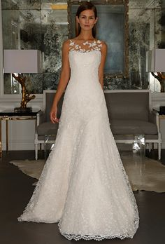 An A-line gown with illusion neckline detailing   @romonakeveza   Brides.com