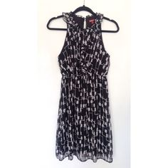 TARGET MERONA Black/White Geometric Ruffle Dress FROM MY PERSONAL CLOSET A fun a flirty dress that flatters any shape. Geometric patter throughout with ruffles down the center. Elastic waist. Button closure on the back collar. Merona Dresses