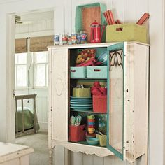 Organize Your Kitchen | Add Vintage Storage Space | SouthernLiving.com  Patty, where is the old china cabinet!