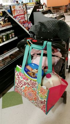 Twin mom hack: when you have to use the double stroller and need some groceries! Use some clips and a big reusable bag.