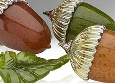 Small glass acorns and green glass leaf