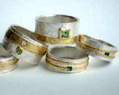 Sterling silver 18ct yellow gold rings with emeralds tsavorite diamond green sapphire.                                                                                                                                                                                 More