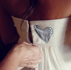 If you sadly have a special-somebody who has passed away, think about incorporating them into your dress. In this case, the bride sewed a love hear of her Dad's shirt into her dress so he could walk her down the aisle.. From Burnetts Boards