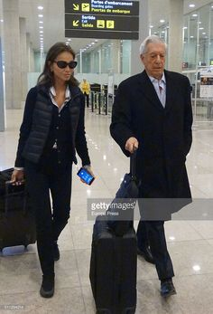 Mario Vargas Llosa and Isabel Preysler are seen arriving at Prat airport on January 12, 2016 in Barcelona, Spain.