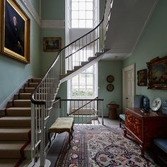 Duck Egg Blue walls & great antiques with a gorgeous staircase.