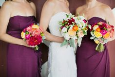 Gorgeous purple bridesmaids dresses and bright bouquets
