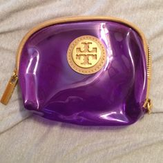 Tori burch penny pouch Purple penny pouch! Used once. Bought online from eBay a while back. Tory Burch Bags Clutches & Wristlets