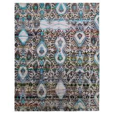 A harmonious fusion of tradition and innovation, this silk rug from the Ethos collection features oversized ikat motifs executed in a spectrum of azure and sky blue tonalities. Emerging from a multi-colored field, -a traditional pattern reinvented through color and dimension. <br/><br/>Hand-knotted in India from vintage sari silk, this one-of-a-kind piece is inspired by a rare collection of 19th-century Central Asian textiles, made contemporary through color and the compelling combination of…