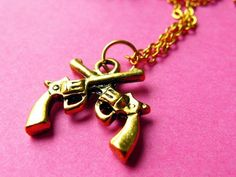 Crossed Guns Necklace - Gold Revolver Charm Necklace. $11.00, via Etsy.