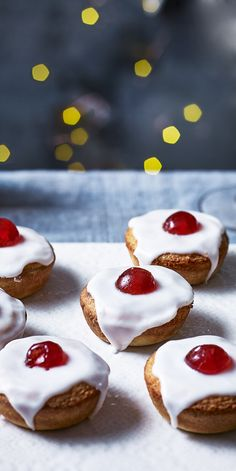 Iced mince pies with a cherry on top! - If you like mince pies AND you love a cherry Bakewell, you have found your Christmas match made in - Tea Recipes, Baking Recipes, Sweet Recipes, Cake Recipes, Christmas Desserts, Christmas Baking, Christmas Foods, Christmas Cakes, Christmas Recipes