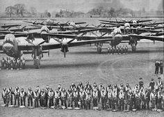 Panoramic view at RAF Wickenby. Sixteen of the crews from 12 and 626 Squadrons lined up in front of the control tower. January 20, 1944.