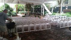 Courtyard ceremony at Terrell House B & B. Featured are white polymer folding chairs.