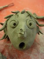 Clay Emotion Head...make a hole on the bottom large enough to glue and insert a pencil after firing