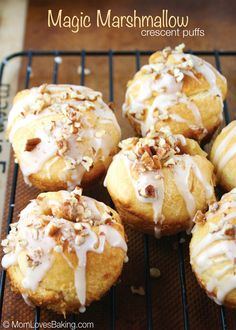 Magic Marshmallow Crescent Puffs - a butter and cinnamon sugar covered marshmallow is wrapped in crescent dough and baked. Topped with icing and nuts. #PillsburyBakeOff #MarshmallowCrescents #SweetRolls