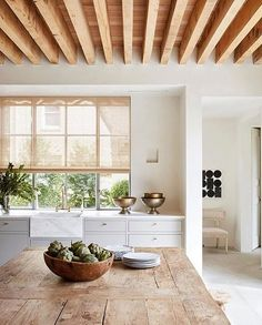 This kitchen is everything we stand for natural, with a touch of glam. We love how the wood ceiling and raw rustic table juxtapose the clean cabinets, gold pulls, and marble sink! Absolutely beautiful design by jilleganinteriors Minimalism Living, Sweet Home, Decoration Inspiration, Decor Ideas, Design Inspiration, Wood Ceilings, Ceiling Beams, Tall Ceilings, Ceiling Art