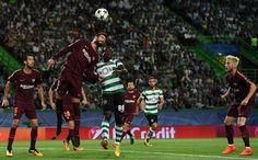 Barcelona's defender  Gerard Pique (L) vies with Sporting's Ivorian forward Seydou Doumbia during the UEFA Champions League Group D football match Sporting CP vs FC Barcelona at the Jose Alvalade stadium in Lisbon on September 27, 2017. / AFP PHOTO / FRANCISCO LEONG