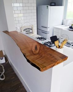 Corianne Burton on Our raw wood bar top went in today, and I am just IN LOVE. Our friend Jeff is a woodworking wizard (haha). Bartheke Kochinsel aus Holz, Kcheinsel mit Tresen, Bar in der Kche Home Decor Kitchen, New Kitchen, Home Kitchens, Copper Kitchen, Kitchen Bars, Kitchen Ideas, Kitchen Inspiration, Awesome Kitchen, Rustic Kitchen