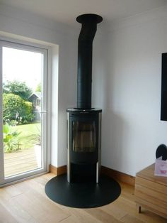 Kernow Fires Contura 655 wood burning stove installation in Cornwall. Corner Log Burner, Wood Burning Stove Corner, Wood Burning Logs, Corner Stove, Stove Fireplace, Fireplace Design, Fireplace Ideas, Living Room With Fireplace, New Living Room