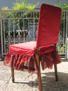 This is my Slip-On Chair Suit®, shown in brilliant red.  Both jacket and skirt are lined.  The seat cover is boxed with a shirred organza skirt and organza ties to connect to the chair.  Each set is custom made to fit your chair.  Dry clean only.